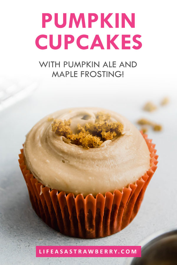 """pumpkin cupcake in a red wrapper on a white surface with text overlay that reads """"pumpkin cupcakes"""""""