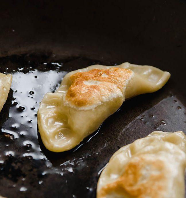 pierogi dumplings in a frying pan