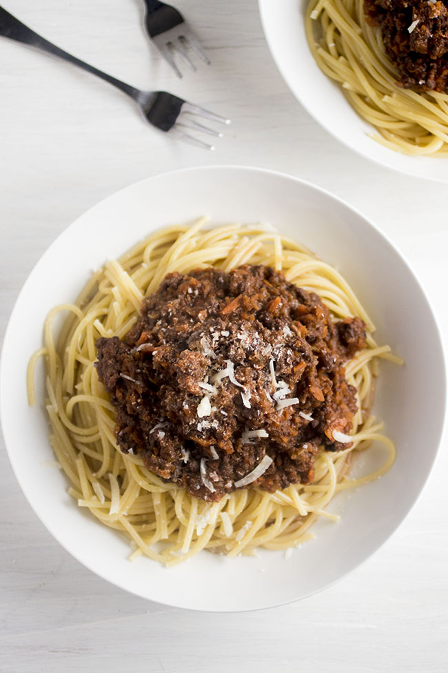Mix up a classic bolognese recipe by adding spicy Italian Sausage in place of beef! A hearty red wine sauce with a vegetable base pairs perfectly with a pile of al dente spaghetti.