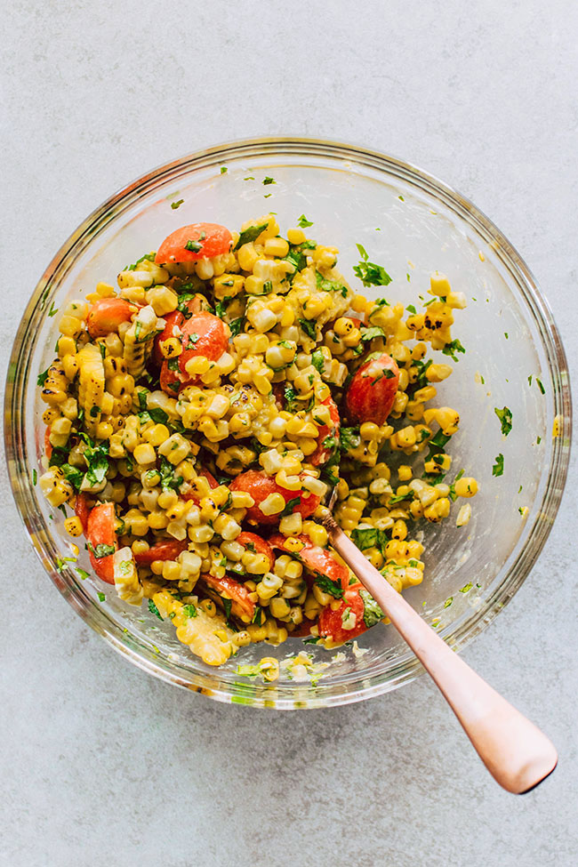 Corn Salsa Recipe - Perfect for summer potlucks and cookouts! An easy corn dip with fresh tomatoes, cilantro, and a quick dijon vinaigrette.