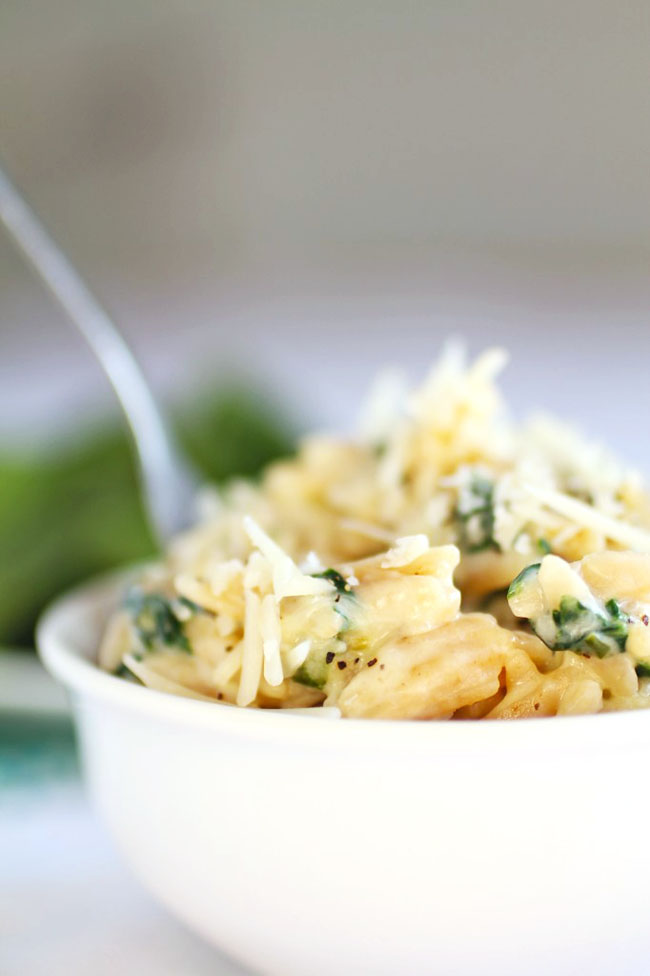 Orzo side dish recipe with spinach and parmesan sauce.