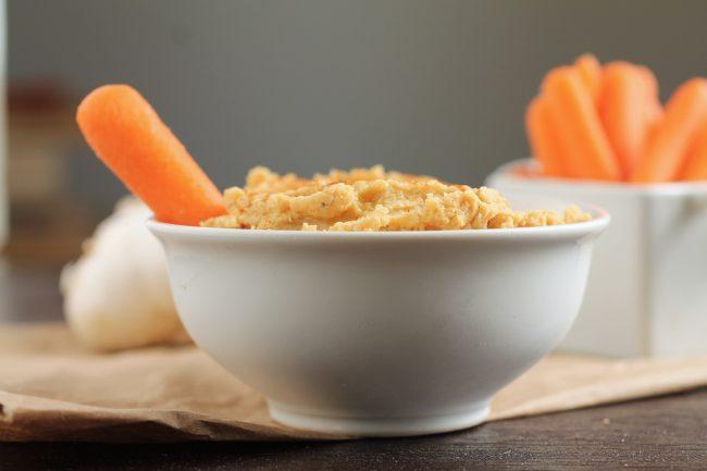 Roasted Garlic Hummus | Make your favorite hummus dip at home with this easy roasted garlic hummus recipe!