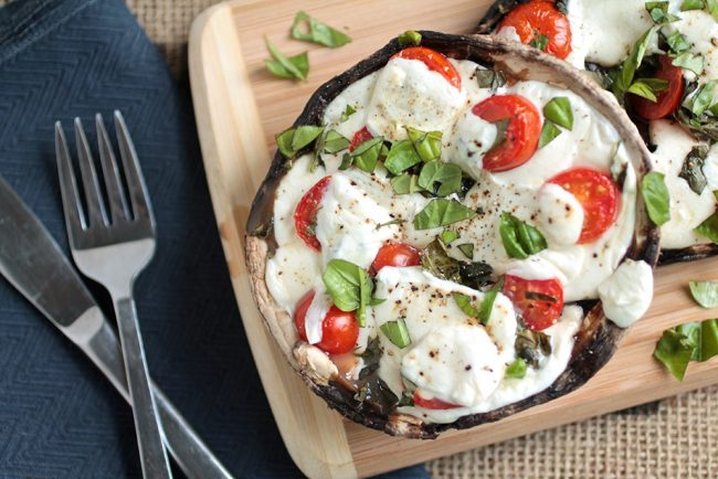 Easy portobello mushroom pizzas are the perfect healthy twist on traditional pizza! Load up a hearty portobello with your favorite pizza toppings. Plus, a trick to help you keep the mushrooms from getting soggy! Vegetarian.
