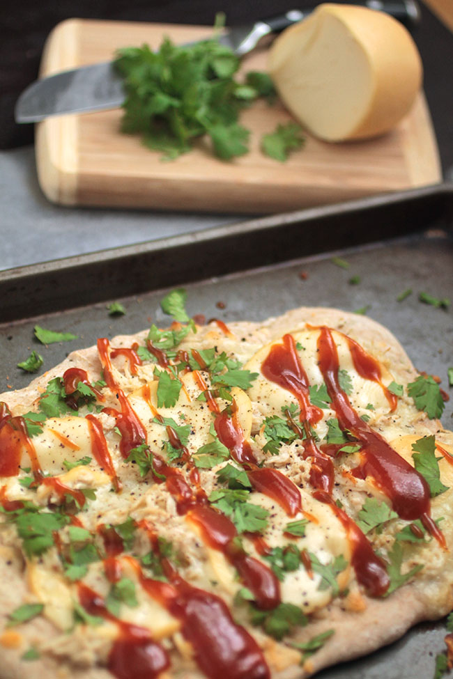 Smoked Mozzarella BBQ Chicken Pizza | This easy homemade pizza recipe features smokey mozzarella cheese, tangy barbecue sauce and fresh chopped cilantro! Faster (and more delicious!) than waiting for takeout.