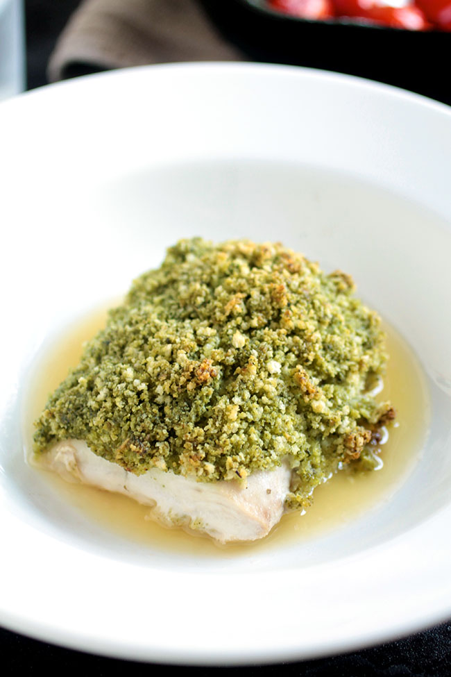 Pesto Crusted Mahi Mahi | This easy weeknight recipe is paired with blistered tomatoes and a simple lemon butter sauce for an easy seafood recipe! Our new favorite mahi mahi recipe.