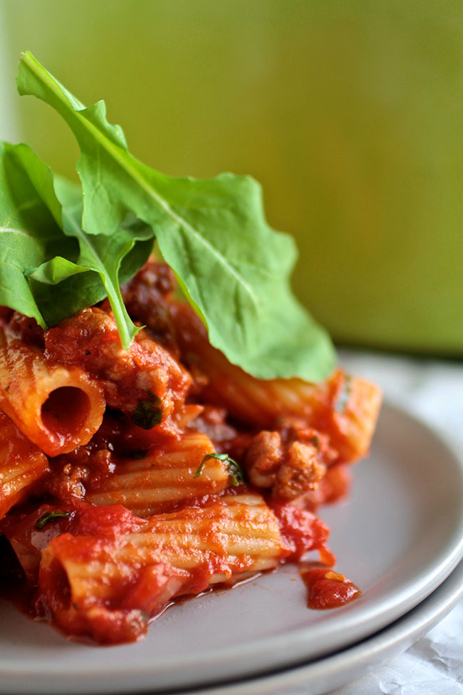 One Pot Spicy Tomato Pasta   This quick and easy pasta recipe is perfect for busy weeknights! Delicious rigatoni pasta, a quick spicy Italian Sausage and tomato sauce, and some fresh arugula give this pasta a fun twist on the classic tomato sauce.