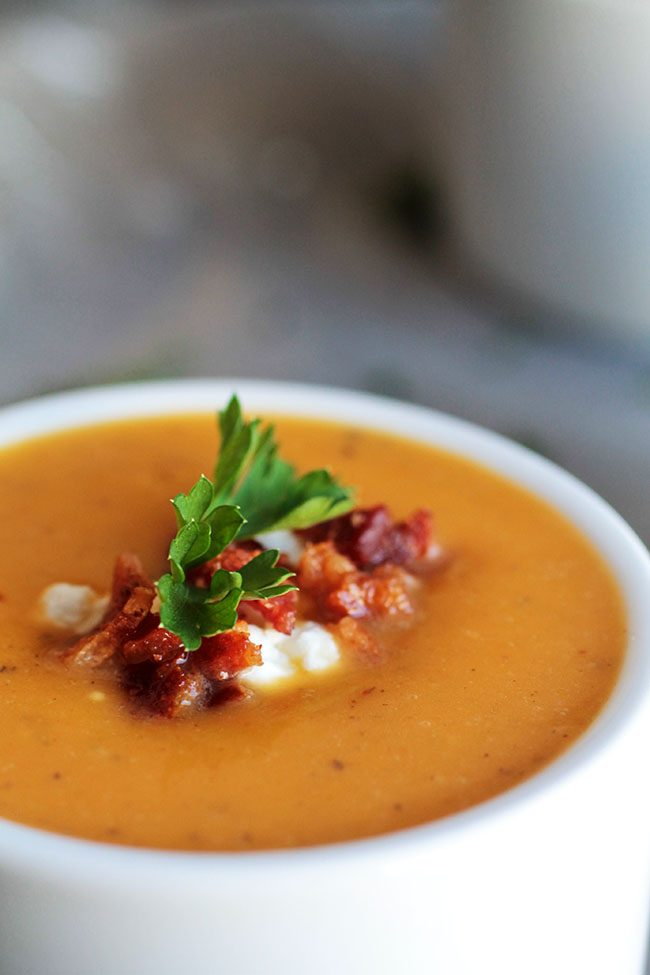 A simple winter squash soup with butternut squash, tangy goat cheese, and a bit of crispy bacon on top!