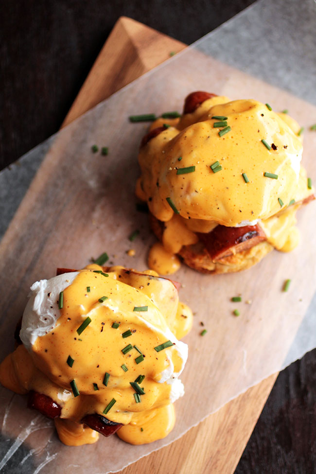 This Cajun Eggs Benedict Recipe is perfect for brunch. Put a twist on traditional eggs Benedict with spicy andouille, homemade spicy hollandaise sauce, and soft cheddar beer biscuits.