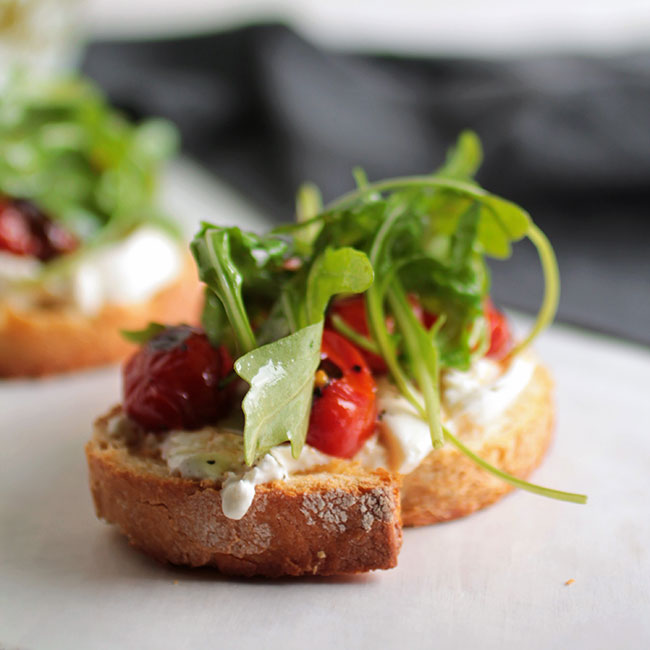 Easy Blistered Tomato and Arugula Crostini