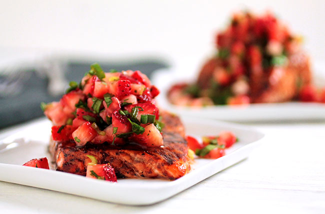 An easy baked salmon recipe with balsamic glaze and strawberry salsa.