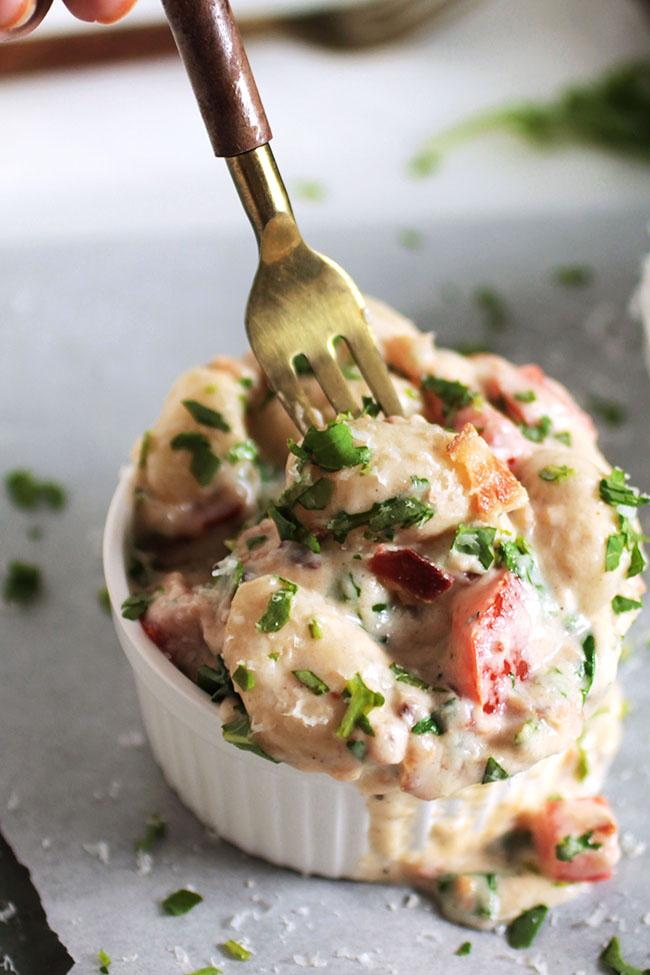 Creamy BLT Gnocchi | This easy potato gnocchi recipe is a fun twist on the classic B.L.T.!  A creamy parmesan sauce, fresh tomatoes, crispy bacon, and fresh chopped arugula make for a hearty, delicious gnocchi pasta recipe.