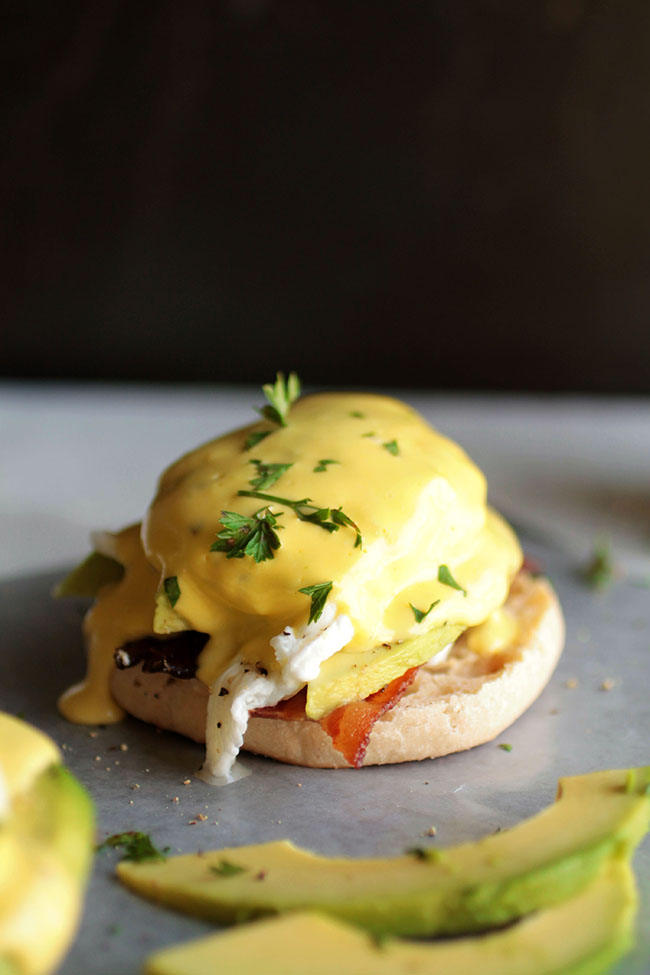 An easy recipe for eggs benedict with avocado hollandaise. Perfect for brunch but easy enough for a quick breakfast!