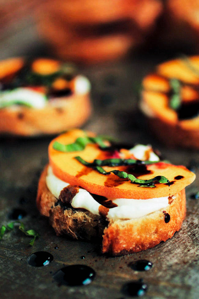 Peach Bruschetta with Whipped Goat Cheese - This easy crostini appetizer has a delicious whipped goat cheese base, topped with fresh peaches, balsamic vinegar drizzle, and fresh basil. Vegetarian.