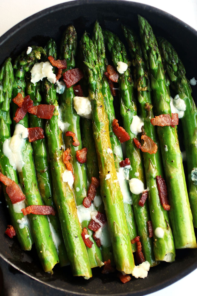 Bacon Blue Cheese Asparagus - Dress up a simple side dish recipe with crispy bacon and creamy blue cheese - this asparagus recipe is sure to be a hit!