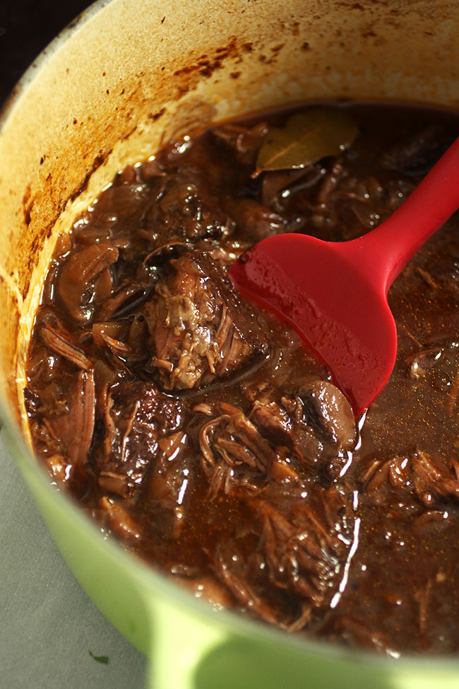 Beef short ribs braising in red wine