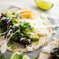 Vegetarian Black Bean Breakfast Tacos | These vegetarian tacos feature delicious spicy black beans and fried eggs for a hearty Meatless Monday meal! This easy vegetarian breakfast recipe is filling, flavorful, and ready in just 30 minutes.