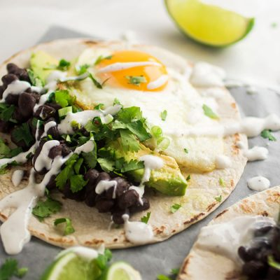 Vegetarian Black Bean Breakfast Tacos   These vegetarian tacos feature delicious spicy black beans and fried eggs for a hearty Meatless Monday meal! This easy vegetarian breakfast recipe is filling, flavorful, and ready in just 30 minutes.