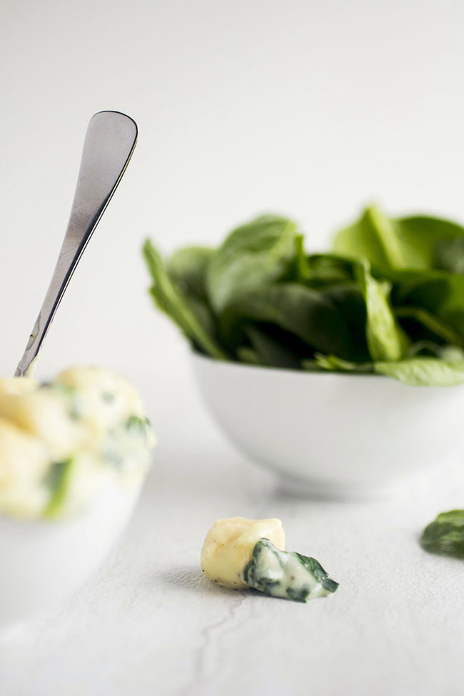 This easy parmesan spinach sauce is the perfect cheesy accompaniment to soft, pillowy gnocchi.