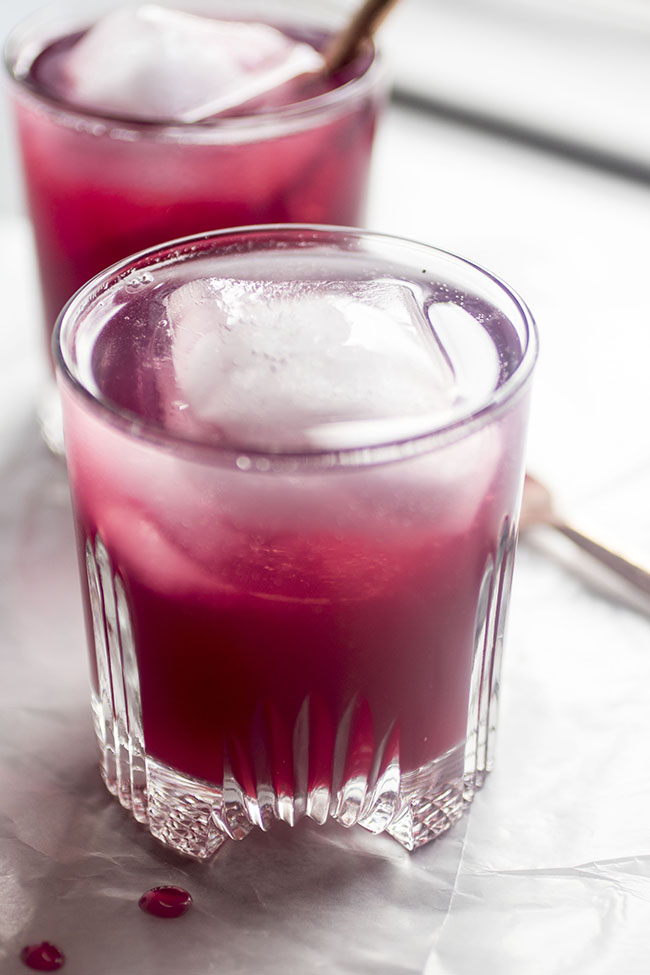 Blueberry Whiskey Spritzers - These easy whiskey drinks are simple to make and full of flavor. Fresh blueberries, lemon juice, and a splash of tonic water make easy whiskey cocktails perfect for summer entertaining. Vegetarian, Vegan.