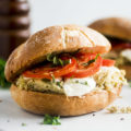 Slow Cooker Chicken Pesto Sandwiches - This easy pesto slow cooker chicken recipe needs just a few ingredients to build a filling and delicious chicken caprese sandwich! It's become one of our favorite crockpot chicken recipes for busy weeknights.