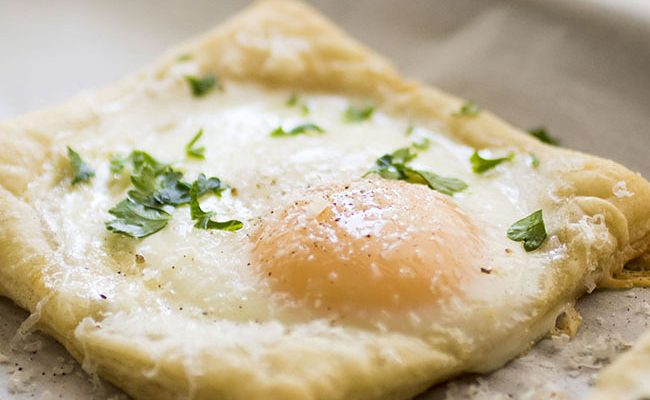 This simple puff pastry baked eggs recipe is easy enough for busy mornings and elegant enough for a Sunday brunch! Includes how-to photos. Vegetarian.