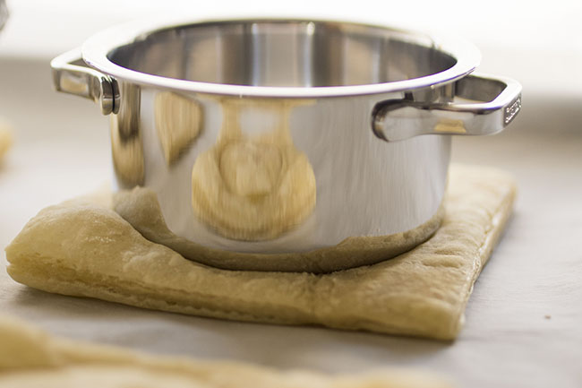 puff pastry weighed down with a small metal pot