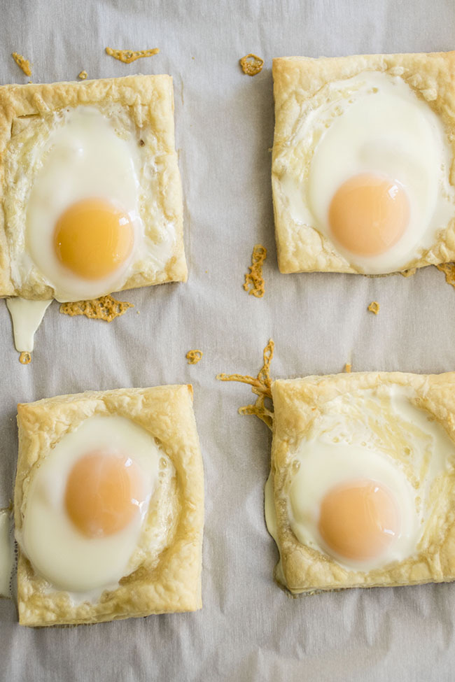 Puff Pastry Baked Eggs - Includes how-to steps and photos so you can get the eggs to stay in their shells and look beautiful without spilling. Vegetarian.