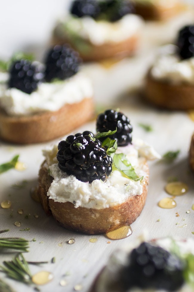 Blackberry Goat Cheese Crostini - This easy goat cheese appetizer recipe is perfect for summer entertaining! A simple whipped goat cheese, fresh summer blackberries, basil and a hint of lime make for a decadent bite that's sure to be a hit. Vegetarian.