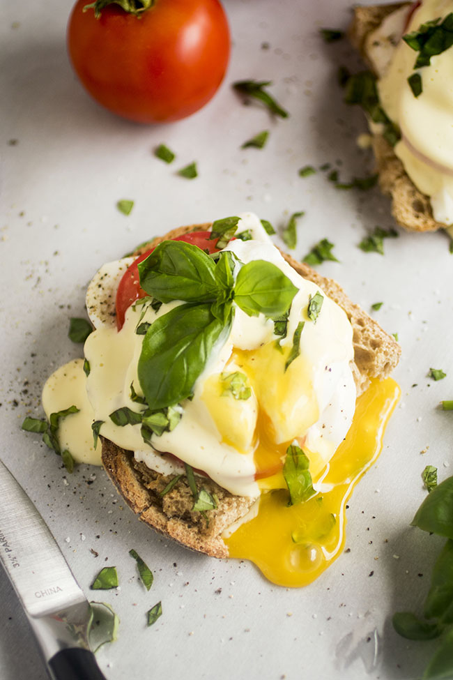Caprese Eggs Benedict - Delicious (and foolproof!) homemade hollandaise sauce, fresh mozzarella, summer tomatoes and chopped basil are the perfect accompaniment to crusty sourdough bread and a creamy poached egg. Vegetarian.