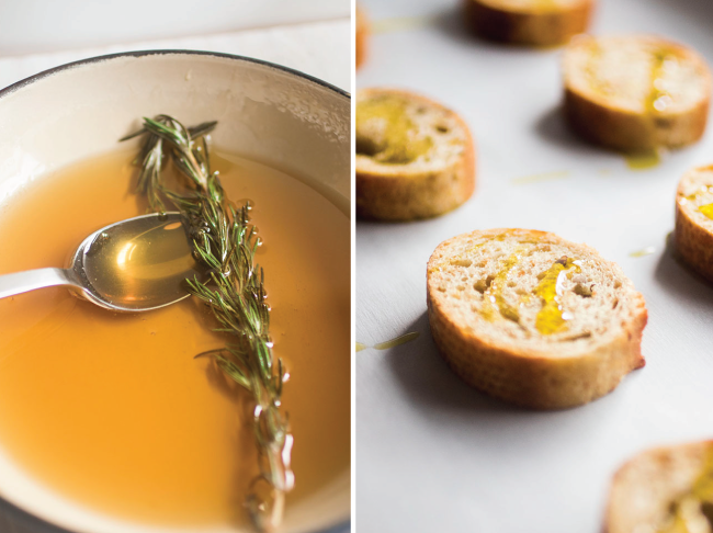 honey in a ceramic skillet with a sprig of rosemary