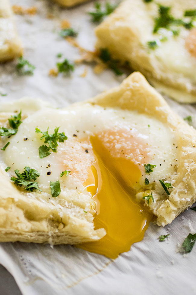 Easy Puff Pastry Baked Eggs - An easy breakfast recipe perfect for busy mornings or Sunday brunch! Includes how-to steps and photos so you can get the eggs to stay in their shells and look beautiful without spilling. Vegetarian.