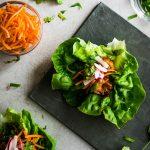 Overhead photo of shrimp lettuce wraps on a dark grey serving tray