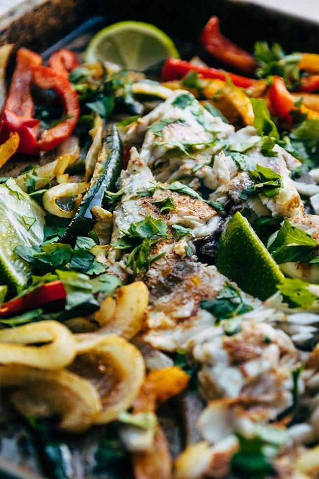Love sheet pan suppers? Try this 30 minute one pan barramundi fajita recipe!
