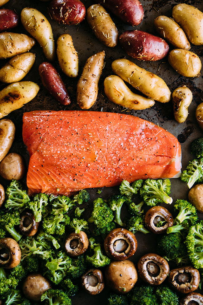 Add this simple baked salmon and potatoes recipe to your list of sheet pan suppers! A quick, simple salmon recipe that's ready in less than an hour.