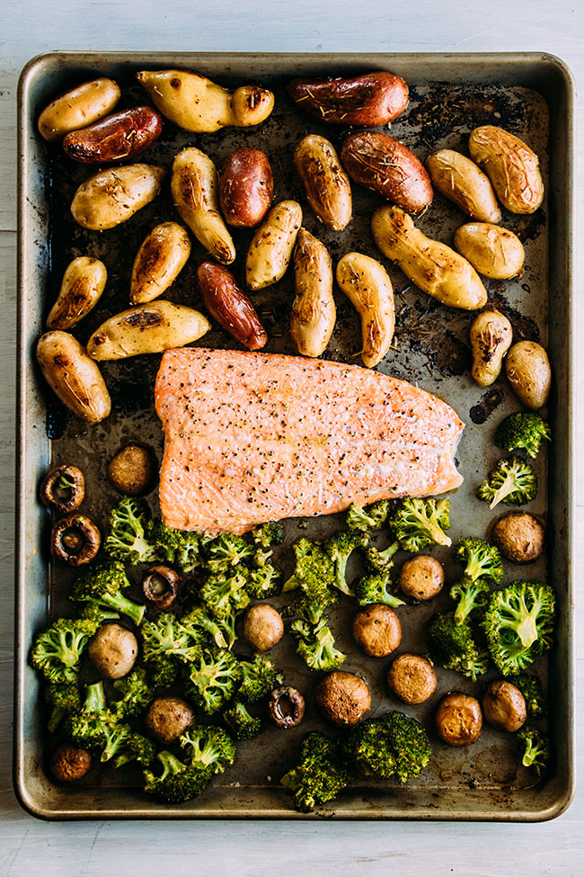 This easy sheet pan dinner features sustainable wild salmon, fingerling potatoes, and hearty vegetables in a one pan recipe. Ready in under an hour!