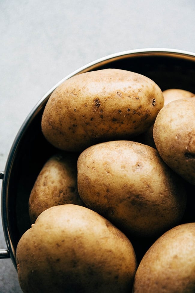 Whole white potatoes for a one pot chicken recipe.