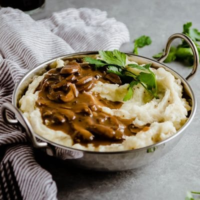 White Cheddar Mashed Potatoes with Mushroom Guinness Gravy
