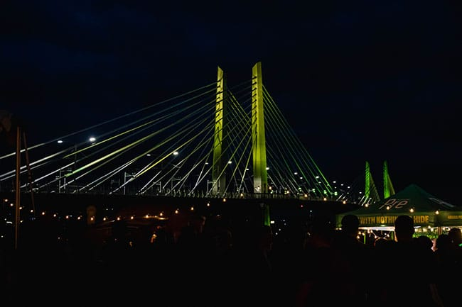 Tillikum Bridge lit up in the evening