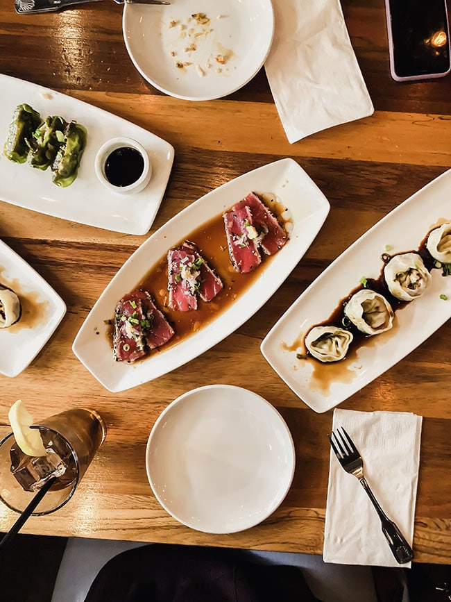 overhead photo of several plates of food at bites restaurant