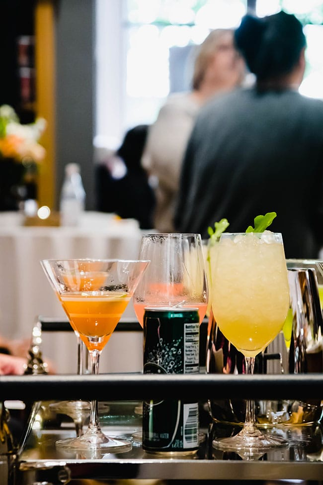 multiple cocktails on a glass table