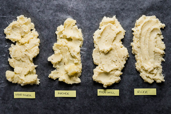 overhead photo of four types of mashed potatoes spread in a line with labels indicating how they were each mashed