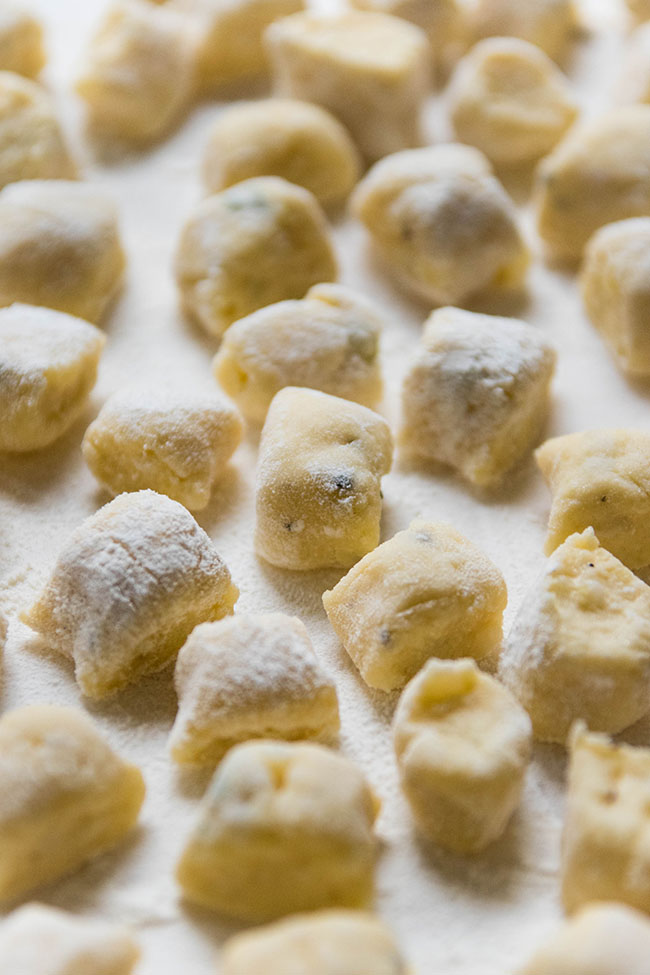 fresh, uncooked gnocchi on a white background