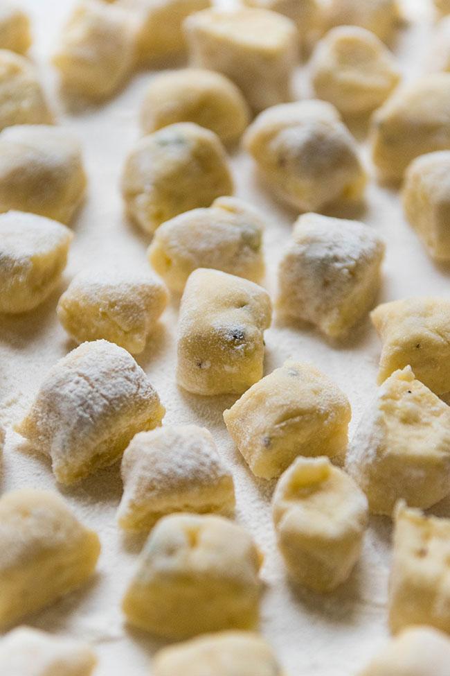 fresh, uncooked gnocchi on a white background