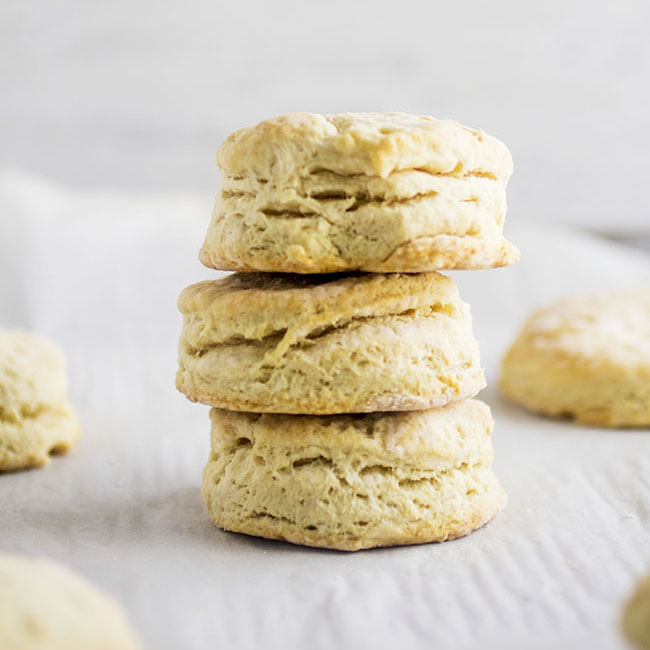 three vegan biscuits in a stack on a white background