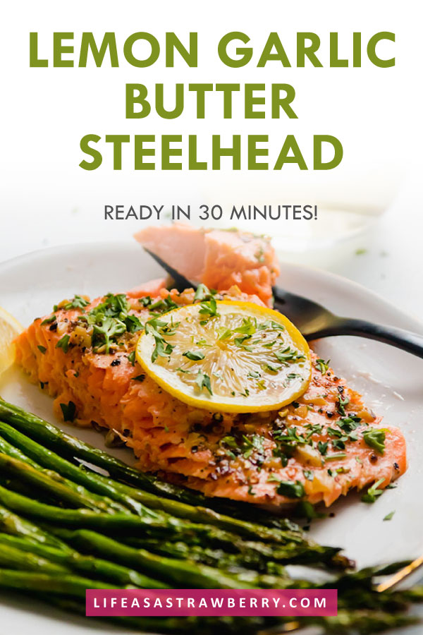 "photo of steelhead trout on a white plate with text overlay that reads ""lemon garlic butter steelhead"""