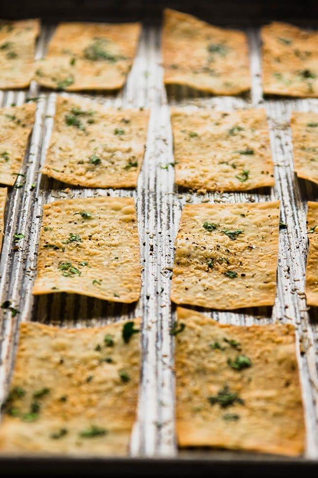 baked wonton crackers on a sheet pan